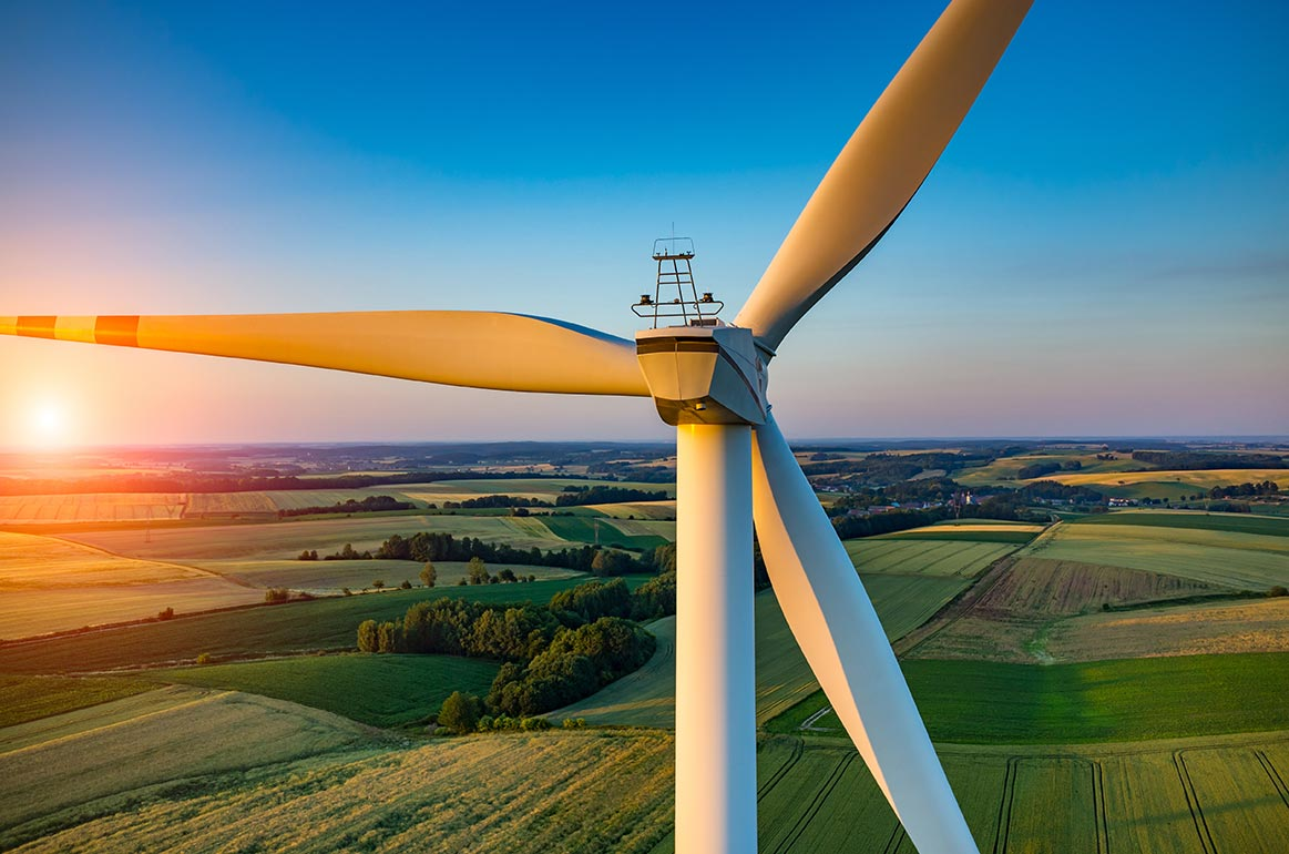 Wind turbine at sunrise with view from above